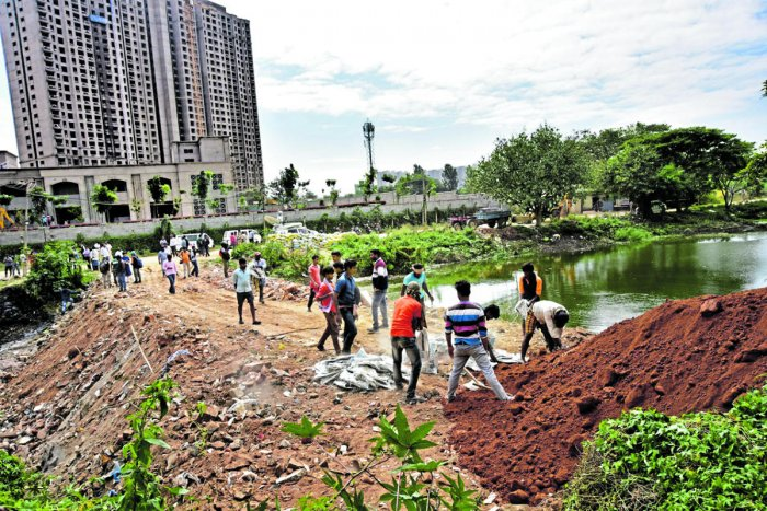 To reduce the water flow into the residential area, the authorities on Sunday had constructed the 10 feet bund using sandbags and debris.