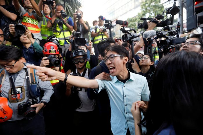 A pro-democratic winning candidate at district council local elections argues with police officers (not pictured) as they walk towards the campus of the Polytechnic University (PolyU) in Hong Kong. Reuters