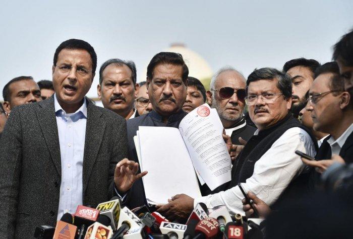 Congress leaders Randeep Surjewala, Prithviraj Chavan and Mukul Wasnik address the media after a hearing at the Supreme Court on Monday. PTI