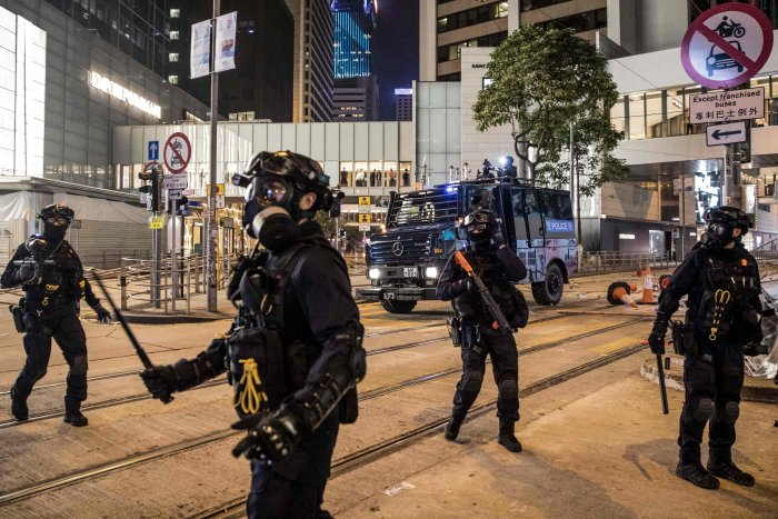 Riot police secure a road after clearing protesters in the Central district in Hong Kong on November 13, 2019. (AFP Photo)