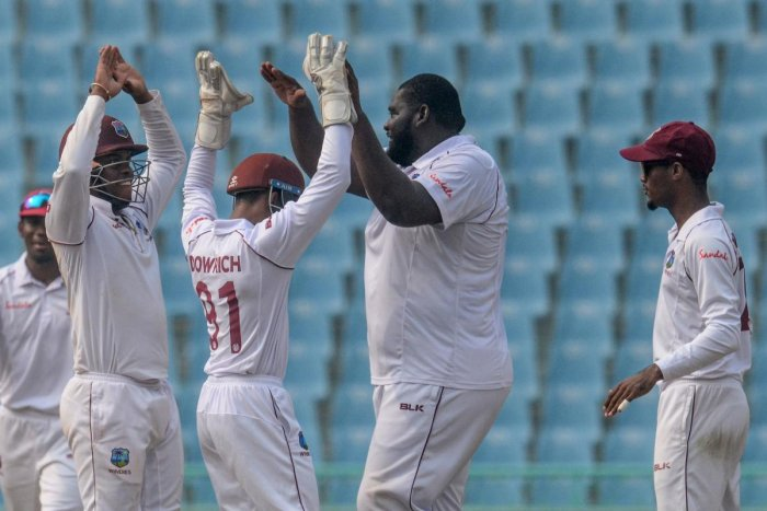 West Indies' cricketers celebrate during the international Test cricket match between Afghanistan and West Indies. (AFP Photo)
