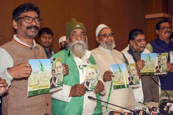 JMM Supremo Shibu Soren with former CM Hemant Soren (L) and other leaders releases their party menifesto for the Assembly elections, in Ranchi, Tuesday, Nov. 26, 2019. (PTI Photo)
