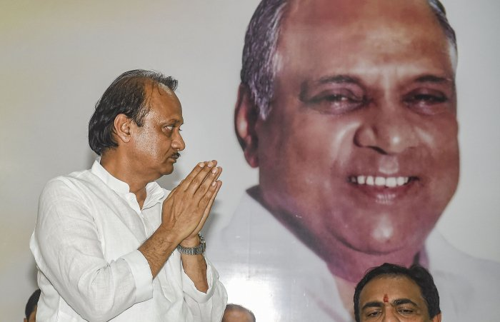 Ajit Pawar gestures after being elected as the Maharashtra NCP legislature party leader, in Mumbai. (PTI Photo)