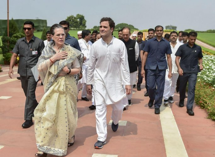Congress President Sonia Gandhi with party leader Rahul Gandhi accompanied by SPG