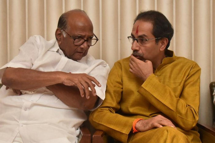 Shiv Sena Party leader Uddhav Thackeray (R) confers with Nationalist Congress Party (NCP) leader Sharad Pawar. (AFP file photo)