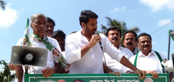 JD(S) youth wing president K Nikhil campaigns for party candidate B L Devaraju, in KR Pet taluk, on Tuesday. MLA Ravindra Srikantaiah, district president D Ramesh and MLC K T Srikantegowda are seen.