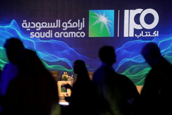 A sign of Saudi Aramco's initial public offering (IPO) is seen during a news conference by the state oil company at the Plaza Conference Center in Dhahran, Saudi Arabia. (Reuters Photo)