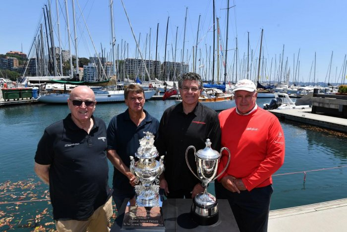 Sydney-Hobart race owners and skippers, (L-R) Bill Barry-Cotter of Katwinchar, Sean Langman of Naval Group, Jim Cooney of Comanche and Iain Murray of Wild Oats XI, pose for a photo in front of trophies at the official launch of the Sydney to Hobart yacht