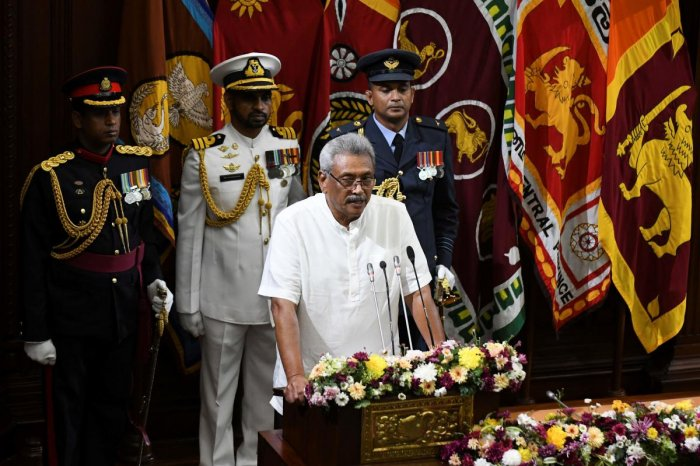 Sri Lanka's President Gotabaya Rajapaksa (C) speaks during a swearing-in ceremony of his bother, Chamal Rajapaksa as country's state minister of defence, in Colombo on November 27, 2019.  (AFP Photo)