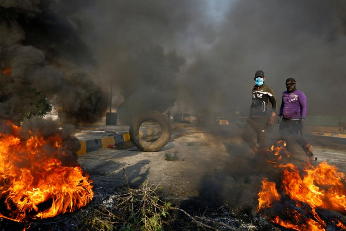 Iraqi anti-government protesters blocked roads in the country's south with burning tyres on Wednesday, as schools and public offices stayed shut a day after deadly clashes with security forces. Photo/REUTERS