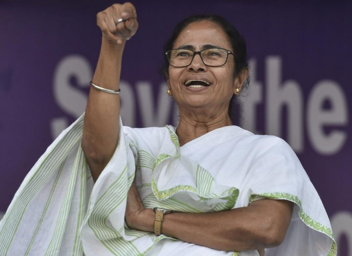 """Dedicating the party's victory to the people of West Bengal, Chief Minister Mamata Banerjee said voters had """"paid back"""" the BJP for its """"arrogance of power"""". (PTI Photo)"""