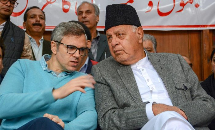 National Conference President Farooq Abdullah with his son, party Vice-President Omar Abdullah during a convention ahead of Lok Sabha elections, at party headquarters, in Srinagar, Saturday, March 30, 2019. (PTI Photo)