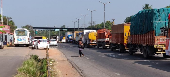 Vehicles queue up at the Surathkal toll plaza.