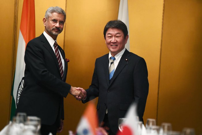 Japanese Foreign Minister Toshimitsu Motegi, right, poses with Indian Minister of External Affairs Subrahmanyam Jaishankar for photographers during a bilateral meeting ahead of the G20 Foreign Ministers' meeting in Nagoya, central Japan