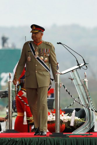 """Prime Minister Imran Khan through an official notification of August 19 granted a three-year extension to General Bajwa, citing """"regional security environment"""". (Photo by Reuters)"""