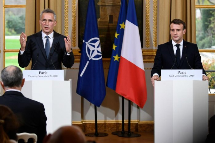 French President Emmanuel Macron and NATO Secretary-General Jens Stoltenberg give a press conference after a meeting at the Elusee palave in Paris. (AFP Photo)