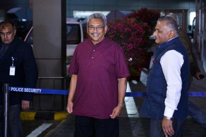 Sri Lanka's President Gotabaya Rajapaksa (C) arrives at the Indra Gandhi International airport in New Delhi