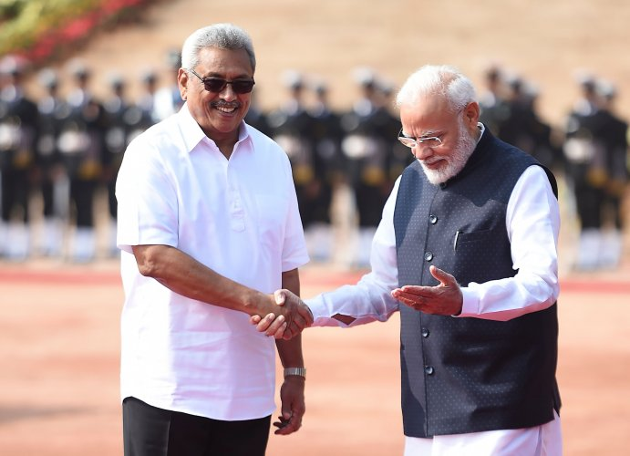 Sri Lanka's President Gotabaya Rajapaksa (L) shakes hands with India's Prime Minister Narendra Modi during a ceremonial reception at the Indian Presidential House in New Delhi on November 29, 2019. (AFP Photo)