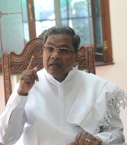 """""""The saffron party has come to power through unethical means by buying legislators. It all began with Anand Singh,"""" Siddaramaiah told the Vijayanagar voters. (File Photo)"""