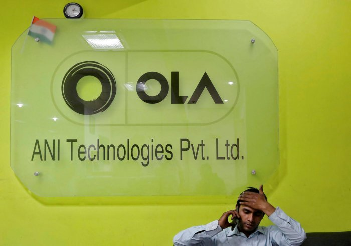 "An Ola spokesperson said the company's ""organisational redesign aims to rightsize all our operations as well as leverage skills sets and experience of mobility employees in available positions in new business verticals"". (Photo by Reuters)"