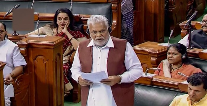 Minister of State for Panchayati Raj Parshottam Rupala speaks in the Lok Sabha during the Winter Session of Parliament. PTI Photo