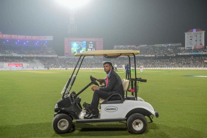 Former Indian cricket captain Rahul Dravid rides in a golf cart during a break on the first day of the second Test cricket match of a two-match series between India and Bangladesh at The Eden Gardens cricket stadium in Kolkata on November 22, 2019. (AFP Photo)