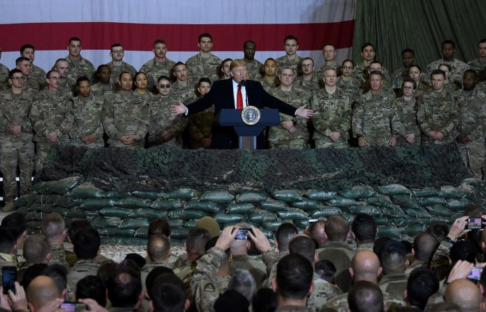 US President Donald Trump speaks to the troops. Photo by AFP