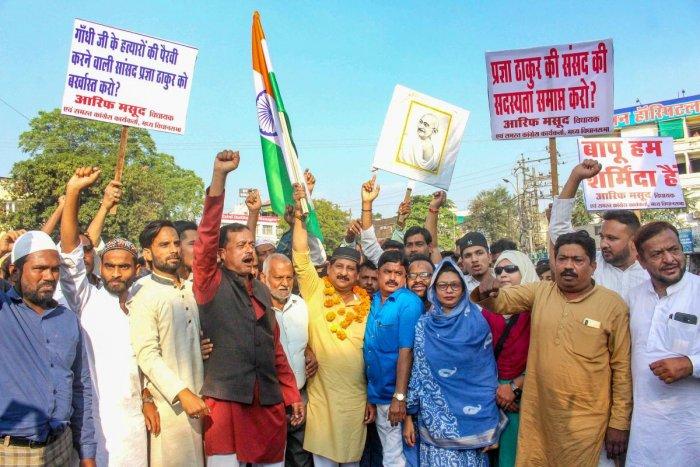 Congress MLA Arif Masood leads party supporters in a protest demanding suspension of BJP MP Sadhvi Pragya Singh Thakur for her remarks on Mahatma Gandhi's assassin Nathuram Godse.
