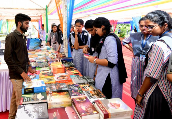 Students browse books at the book exhibition organised as part of Mangaluru Lit Fest 2019 at Dr T M A Pai International Convention Centre on Friday.