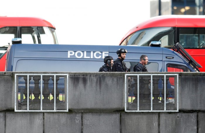 Police officers and emergency staff work at the site of an incident at London Bridge. Reuters