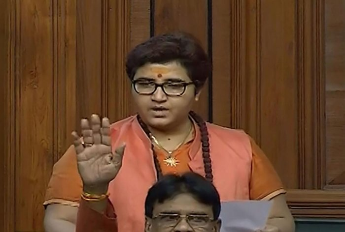 "Amid sloganeering by Opposition members, Pragya, the Lok Sabha member from Bhopal, claimed that her remarks were ""twisted"" and later hit back at the Congress by submitting a breach of privilege notice against Rahul Gandhi for calling her a terrorist. Photo/PTI"