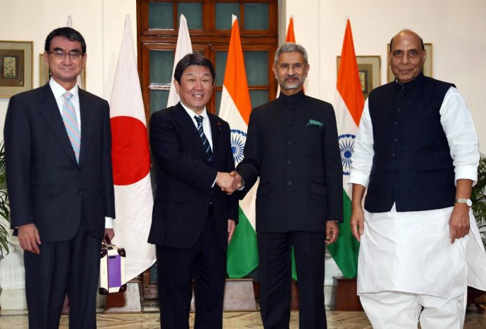 Japan's Foreign Minister Toshimitsu Motegi (2L) shakes hands with his Indian counterpart Subrahmanyam Jaishankar (2R) as India's Defence Minister Rajnath Singh (R) and Japan's Defence Minister Taro Kono (L) pose during their bilateral talks in New Delhi. (AFP Photo)
