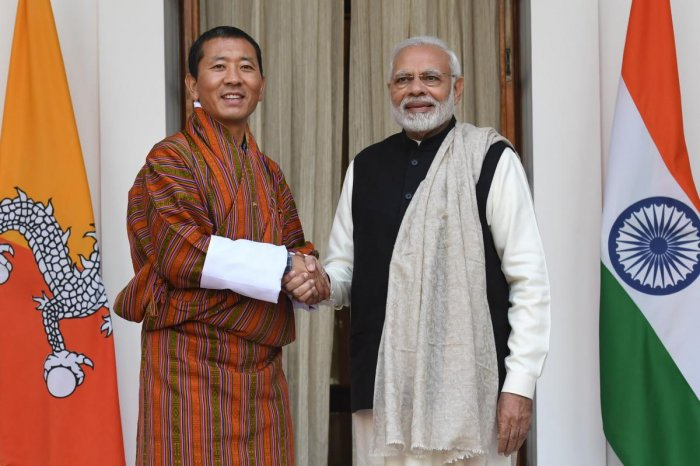 Indian Prime Minister Narendra Modi (R) shakes hands with Bhutan's Prime Minister Lotay Tshering. (AFP Photo)