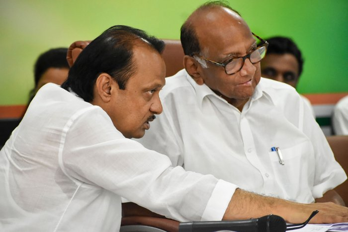 Nationalist Congress President (NCP) Sharad Pawar with party leader Ajit Pawar. (PTI Photo)