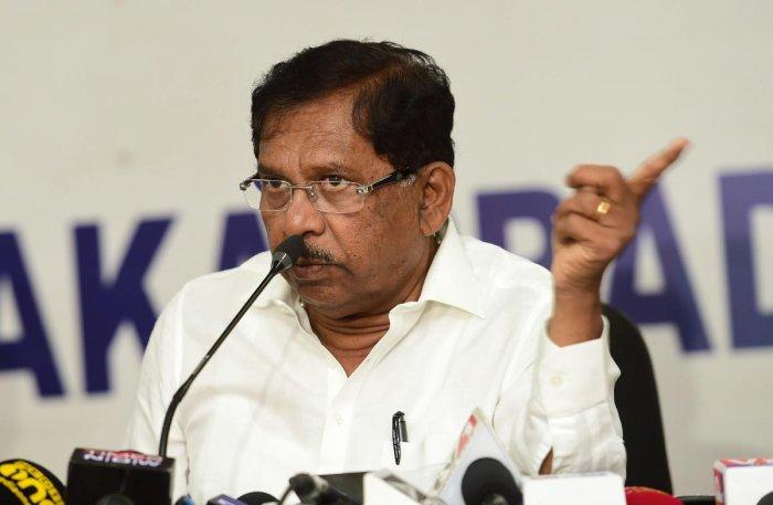 Karnataka Pradesh Congress Committee President G Parameshwara addresses a press conference, a day after polling for Karnataka Assembly elections. (PTI Photo)