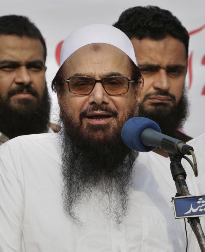 Hafiz Saeed, founder of Pakistani religious group Jamaat-ud-Dawa addresses an anti-Indian rally in Lahore, Pakistan. Pakistani authorities say they have arrested Saeed, a radical cleric and U.S.-wanted terror suspect blamed for the 2008 Mumbai attacks. (P