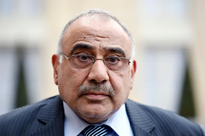 A file photo taken on April 2, 2015 shows then Iraq's oil minister, Adel Abdel Mahdi, listening to questions by the press after a meeting with the French president at the Elysee palace. (AFP Photo)