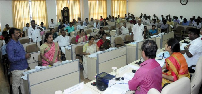 Members raise a point at the Zilla Panchayat meeting which was presided by the president of the zilla panchayat, Dinakar Babu, at the Zilla Panchayat Hall in Manipal.