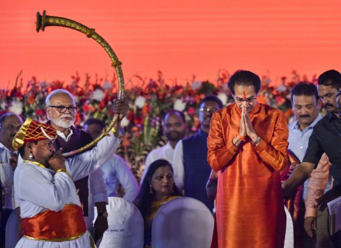 Shiv Sena President Uddhav Thackeray greets his supporters during his swearing-in ceremony as the 18th Chief Minister of Maharashtra, at Shivaji Park in Mumbai, Thursday, Nov. 28, 2019. (PTI Photo)
