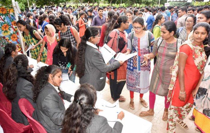 Job aspirants register during the job fair, organised at Karnataka State Open University in Mysuru on Saturday. ( dh photo