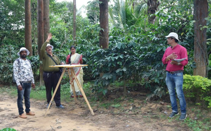 The survey work on the land being carried out as per the direction of the court at Bettadakadu.