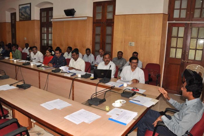 Deputy Commissioner Dr Bagadi Gautham chairs a meeting in Chikkamagaluru.
