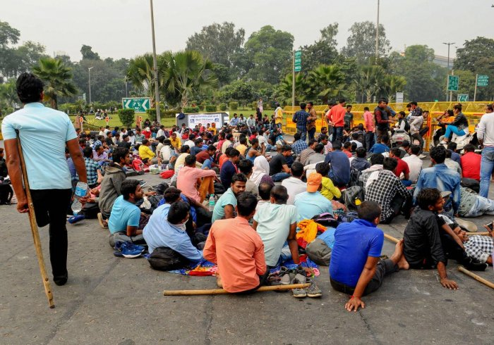 People with disabilities block a road during a protest against the invalidation of railway examination results, near Mandi House in New Delhi, Tuesday, Nov. 26, 2019. (PTI Photo)