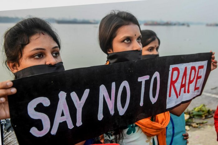 Social activists hold a poster with their mouths covered as they protest against the recent alleged rape and murdered of a of a 27-year-old veterinary in Hyderabad. (AFP photo)