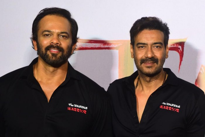 Indian Bollywood director and producer Rohit Shetty (L) and actor Ajay Devgn. (AFP Photo)