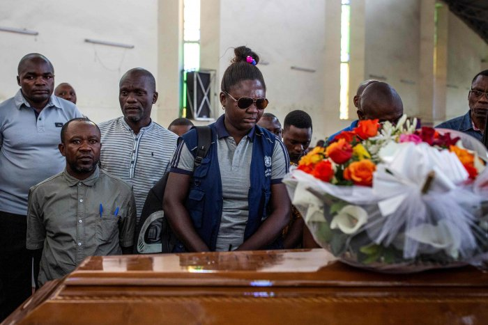 Family and colleagues of Belinda Kasongo, 30, who was part of the Ministry of Health vaccination team and was killed by armed men. (AFP Photo)