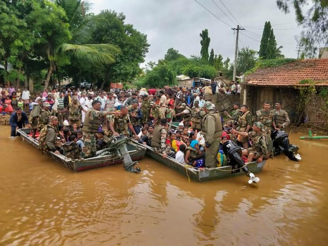 Army personnel carry out rescue operation in a flood affected area in Belagavi district. PTI