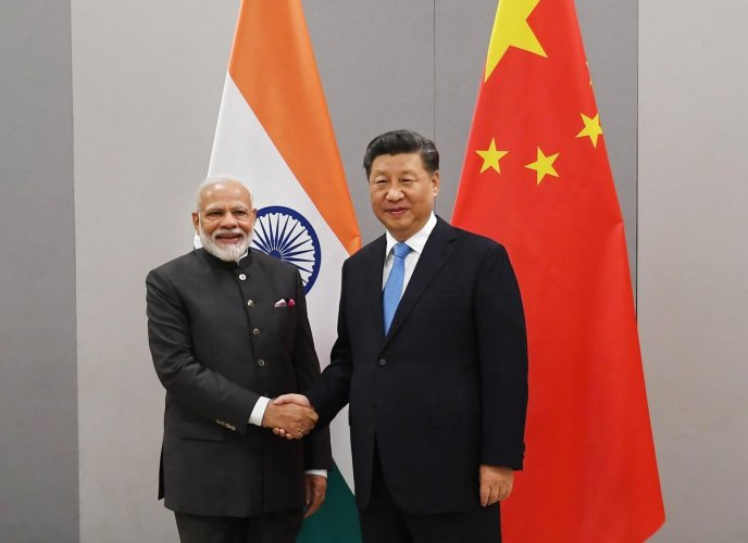 Prime Minister Narendra Modi shakes hands with Chinese President Xi Jinping during a meeting on the sidelines of BRICS Summit, in Brasilia, Brazil, Wednesday, Nov. 13, 2019. (PTI Photo)