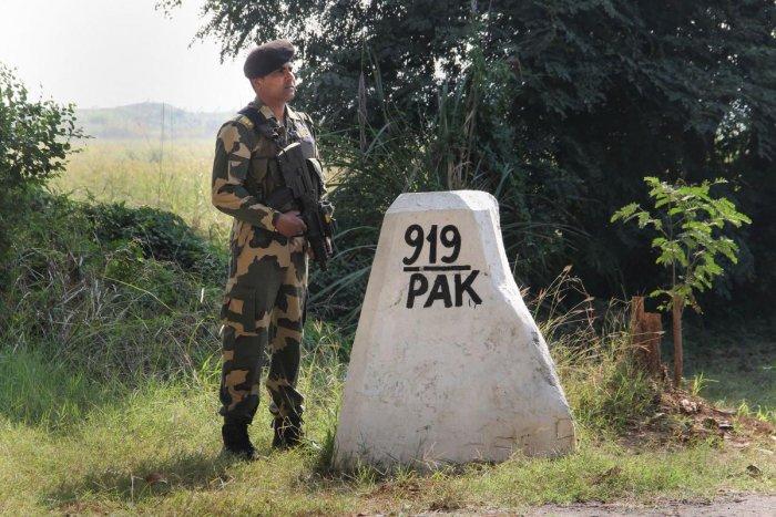 Border Security Force (BSF) jawan stand guard at India-Pakistan International border, at Ranbir Singh Pura in Jammu, Monday, Nov. 18, 2019. (PTI Photo)