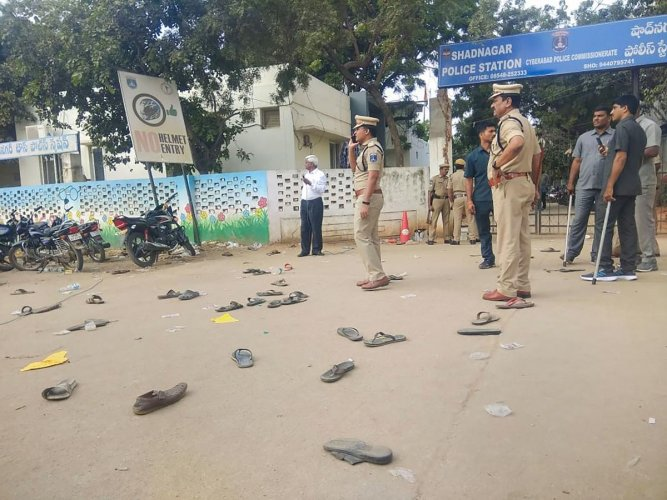 Footwear's lie on the road after clashes between protestors and police during a demonstration demanding justice for P Priyanka Reddy, who was working as an assistant veterinarian at a state-run hospital and whose charred remains was found under a culvert,  in Hyderabad, Saturday, Nov. 30, 2019. (PTI Photo)